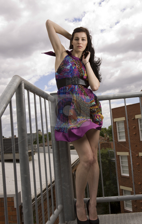 Young model stock photo, Beautiful model poses outside in a colorful dress by Jandrie Lombard