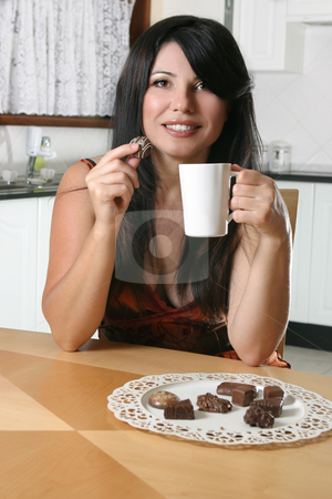 Chocolates and coffee stock photo, A beautiful woman enjoys coffee and chocolates. by Leah-Anne Thompson