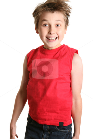 Child jumping and smiling stock photo, A child in casual clothes jumps up and down in excitement. by Leah-Anne Thompson