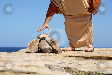 Man by stones  concept Sin Punishment  stock photo, Closeup of a man dressed in anicent clothing standing by a pile of stones bending over to pick one up - concept  stoning, sin, punishment,  Stoning was used in many ancient cultures for crimes. Stoning of animals was also carried out if that animal killled a person. Stoning is still allowed in Iran, Nigeria, Afganistan, Pakistan. by Leah-Anne Thompson