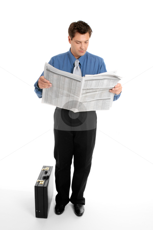 Businessman reading newspaper stock photo, A businessman reads the finance newspaper while waiting for bus, train, taxi.  Newsprint has been blurred. by Leah-Anne Thompson