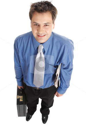 Successful businessman stock photo, Confident smiling professional businessmen stands with the financial newsaper under one arm and carrying a briefcase with the other.. by Leah-Anne Thompson