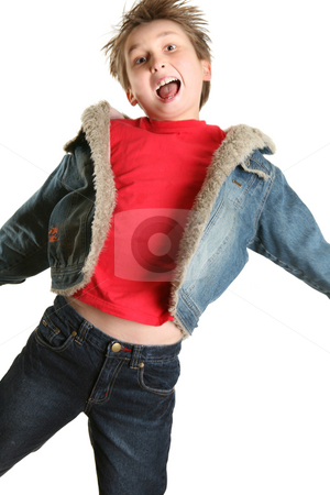 Exuberant Child Jumping for Joy stock photo, Child wearing plain red shirt, denim jacket and jeans mid jump.   Some parts in slight motion. by Leah-Anne Thompson