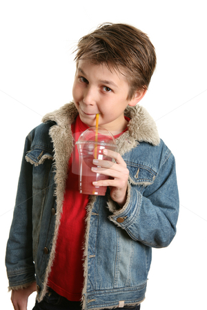 Drink to good health stock photo, Child drinking a juice of raspberry, cranberry and apple.  Berries are a good source of vitamins and phytochemicals.  They also contain lutein, which is important for healthy vision . by Leah-Anne Thompson