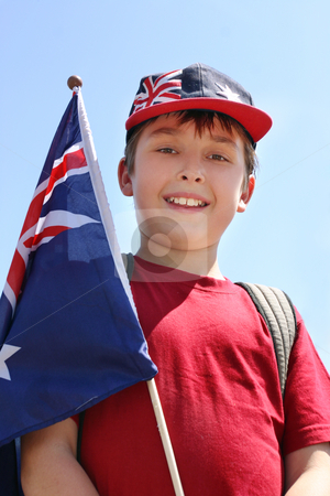 Smiling boy with flag stock photo, Smiling young boy outdoors holding a flag by Leah-Anne Thompson