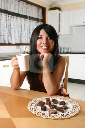 Woman indlulges in chocolate and coffee stock photo, A woman indulges in coffee and decadent chocolate truffles by Leah-Anne Thompson