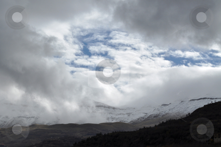 Clouds and Sky stock photo, Mountains covered with snow with a beautiful sky above them by Tony Abdou