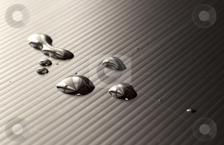 Drops stock photo, Drops of water over a black background by Fabio Alcini