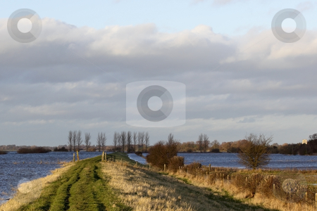 Winter floods 6 stock photo, A view along the defensive banks of the river derwent in yorkshire during the winter floods by Mike Smith
