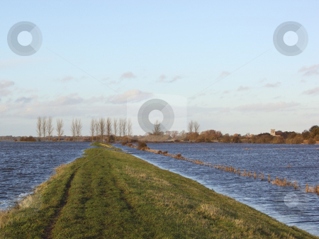 Winter floods stock photo, Water flooding over the defensive banks of the river derwent in yorkshire by Mike Smith