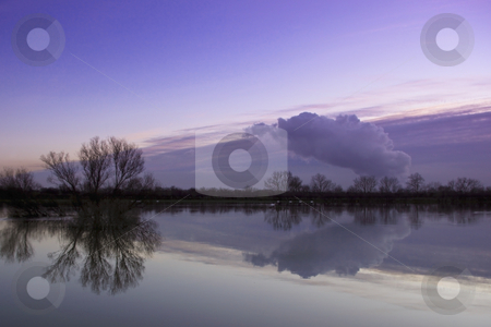 Colored sky and water stock photo, A colorful sky over flooded grassland on a cold winter evening by Mike Smith