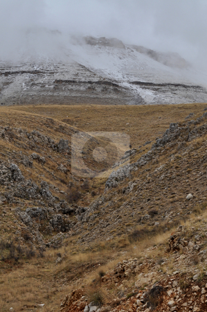 Valley  stock photo, A Small Valley First than towering mountains with snow by Tony Abdou