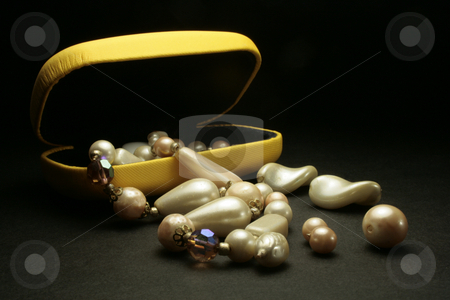 Pearls stock photo, Closeup of pearls in a  yellow box on black background by Marina Magri