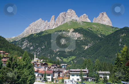 Alba di Canazei, val di Fassa stock photo, Panorama of Alba di Canazei and Fassa valley with Sassolungo mount (Langkofel) behind. Photo taken with polarizer filter by ANTONIO SCARPI