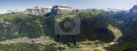 Val di Fassa panorama stock photo, Aerial view of Canazei and Fassa valley with Saas Pordoi mount (Sella group), Pordoi pass and Fedaia pass by ANTONIO SCARPI