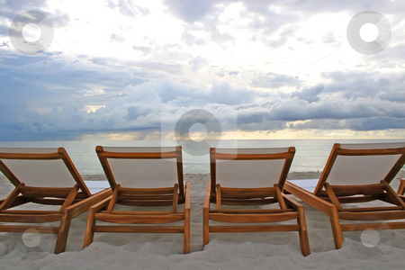 Beach Chairs stock photo, Four beach chairs face the ocean by Candace Beckwith