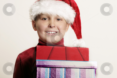 Child bearing gifts stock photo, Child holding christmas gifts by Leah-Anne Thompson