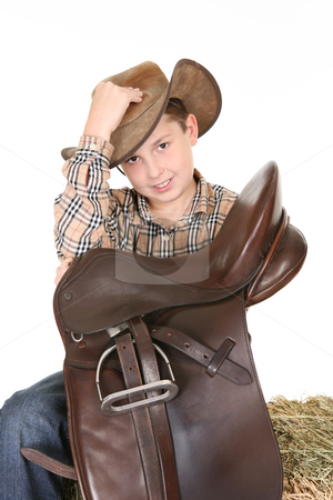 Horse rider tips his hat stock photo, Young horse rider respectfully tips his hat in greeting. by Leah-Anne Thompson