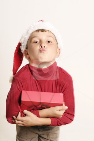 Christmas Kiss stock photo, Appreciation of gift by Leah-Anne Thompson