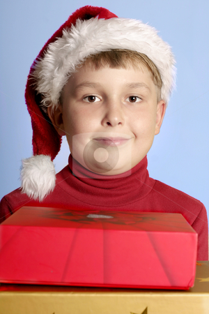 Christmas Gifts stock photo, Child holding gift boxes by Leah-Anne Thompson