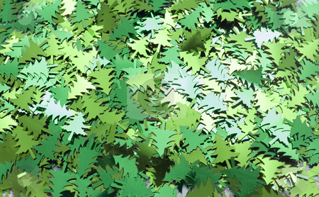 Foil Christmas Trees stock photo, Background of green coloured metallic christmas confetti reflecting in the light by Stephen Gibson