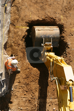 The Dig Begins stock photo, A machine digs a hole at a construction site.  Above Perspective. by Leah-Anne Thompson