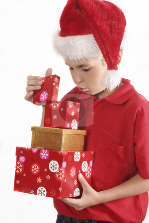 Look Inside stock photo, A child llifts the lid and looks inside a box. by Leah-Anne Thompson
