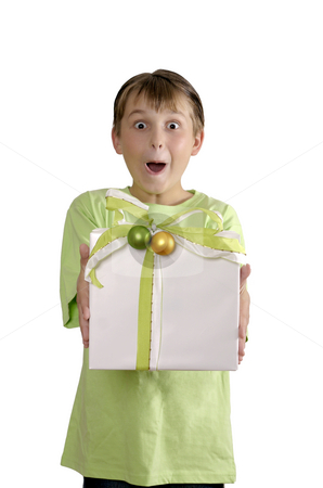 Excited boy holding a wrapped present stock photo, Excited wide eyed boy holding a present wrapped with green white and gold ribbon and finished with green and gold baubles. by Leah-Anne Thompson