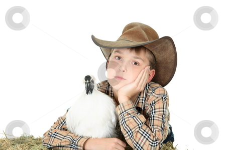 Country boy with farm animal with copyspace stock photo, Country boy relaxing casually with a white silkie bantam. Silkie bantams are very docile and make excellent pets.  Space for copy by Leah-Anne Thompson