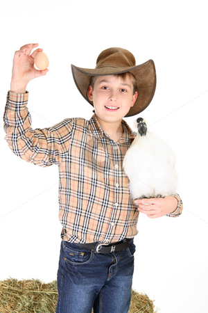 Boy with chicken and egg stock photo, Farm boy with a small bantam and a chicken egg. by Leah-Anne Thompson