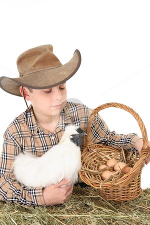 Farm boy with basket of eggs stock photo, A farm boy with a basket of eggs.  Space for copy by Leah-Anne Thompson