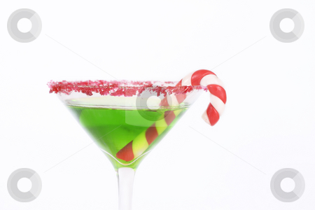 Christmas Drink stock photo, Green alcoholic drink edged in red with a candy cane decoration.Christmas drinks, work party, celebrations, etc. by Leah-Anne Thompson