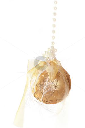 Decorated Christmas ornament stock photo, Gold glass bauble decorated and tied with ribbons and pearls by Leah-Anne Thompson