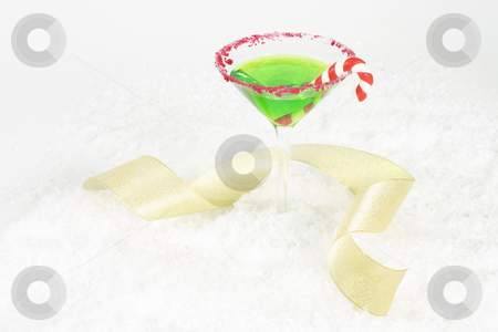 Christmas Party  stock photo, Christmas martini and gold curling ribbon - landscape. by Leah-Anne Thompson