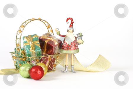 Christmas Things stock photo, A basket of presents,glitter baubles, ribbon and christmas elf on a white background. by Leah-Anne Thompson
