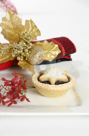 Christmas Fruit Pies stock photo, Fruit mince pie on a plate adorned with Australian Christmas bush and napkin. by Leah-Anne Thompson