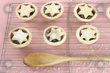 Sweet fruit pies stock photo, Little fruit pies with star tops and wooden spoon by Leah-Anne Thompson