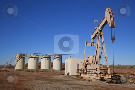 Oil Well stock photo, Oil well with Storage Tanks in the tackground by Mark Smith