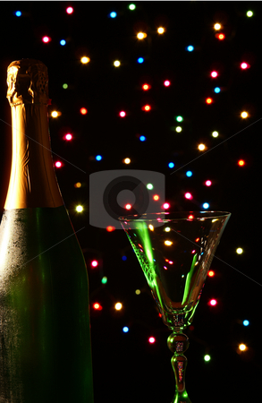 Champagne stock photo, Champagne and glass on background colorful lamp by Jolanta Dabrowska