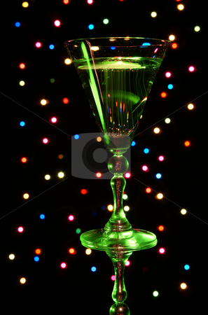 Champagne  stock photo, Green glass with champagne on background colorful lamp by Jolanta Dabrowska