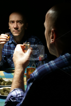 Alcoholic stock photo, Lonely drinking  man with reflection in mirror by Jolanta Dabrowska