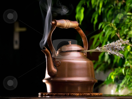Lavender tea stock photo, Hot lavender tea in a copper teapot on the table. by Sinisa Botas