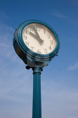 Old Clock stock photo, An old exterior clock with blue sky and clouds. by Travis Manley