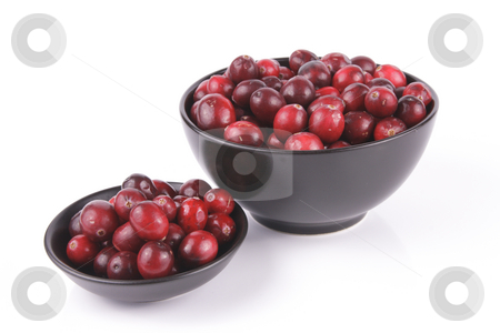 Cranberries in a Black Bowl stock photo, Red ripe cranberries in a small round black bowl and a larger black bowl with a reflective white background by Keith Wilson