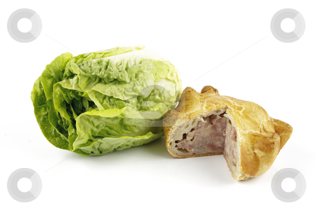 Salad Lettace and Pork Pie stock photo, Contradiction between healthy food and junk food using a green salad lettace and pork pie on a reflective white background by Keith Wilson