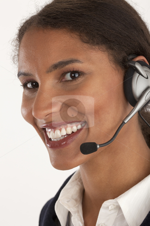Young Businesswoman with Mobile Device stock photo, Closeup of young businesswoman wearing headset. Vertically framed shot. by Edward Bock