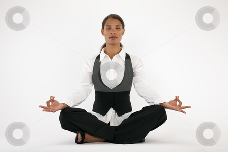 Young Woman Meditating stock photo, Young woman sitting cross legged and meditating. Horizontally framed shot. by Edward Bock