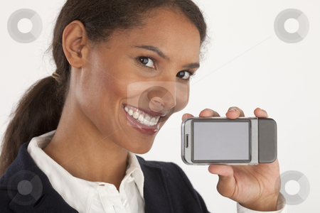 Young Businesswoman with Mobile Device stock photo, Closeup of young businesswoman holding mobile device. Horizontally framed shot. by Edward Bock