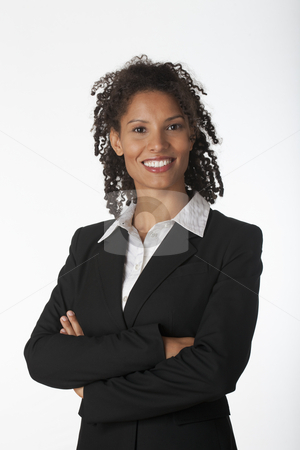 Young Business Woman stock photo, Young business woman with arms crossed. Vertically framed shot. by Edward Bock