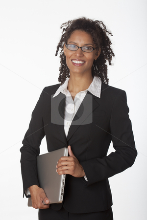 Young Business Woman stock photo, Young businesswoman holding laptop. Vertically framed shot. by Edward Bock